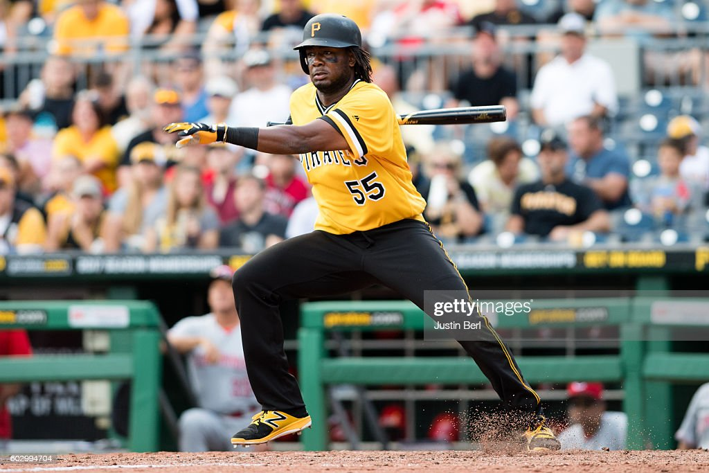 Josh Bell #55 of the Pittsburgh Pirates reaches on a fielding error by Eugenio Suarez #7 of the Cincinnati Reds in the seventh inning during the game at PNC Park on September 11, 2016 in Pittsburgh, Pennsylvania.