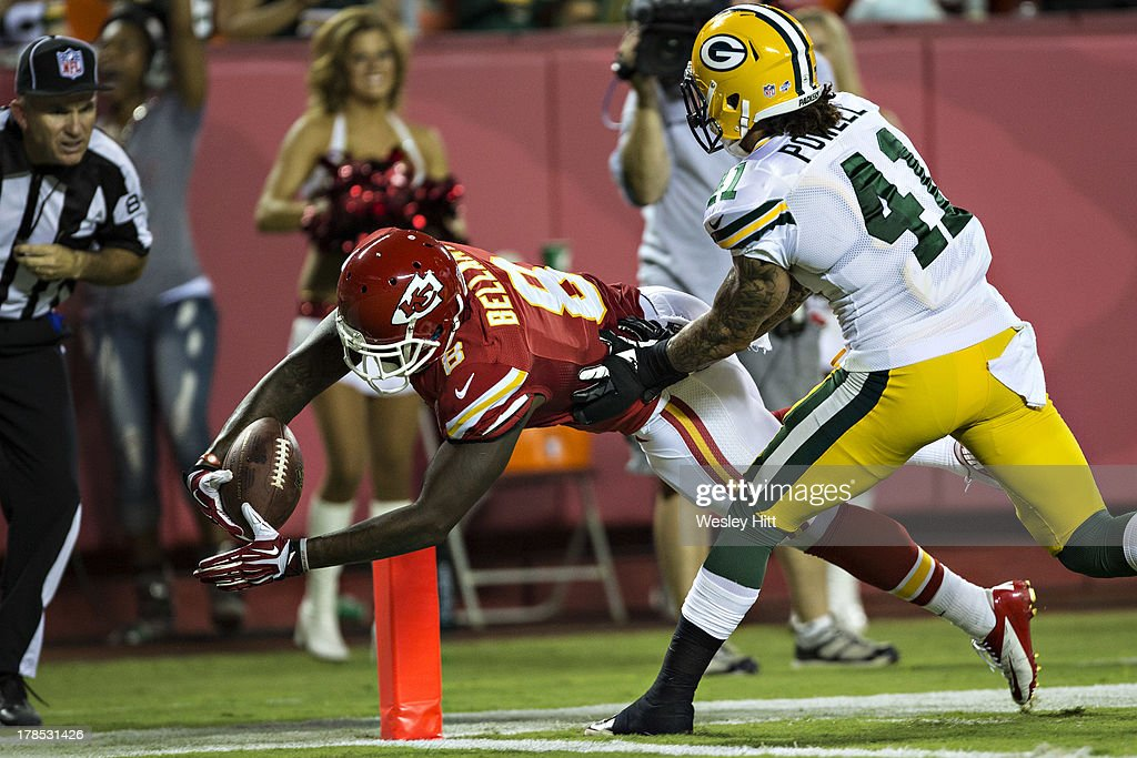Josh Bellamy #8 of the Kansas City Chiefs dives for a touchdown past Chaz Powell #41 of the Green Bay Packers during the last preseason game at Arrowhead Stadium on August 29, 2013 in Kansas CIty, Missouri.