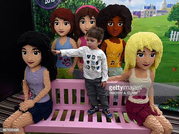 Josh Bertram plays with Lego figures after viewing a fullsize replica of its new room theme during a media event in New York March 24 2015 to promote...