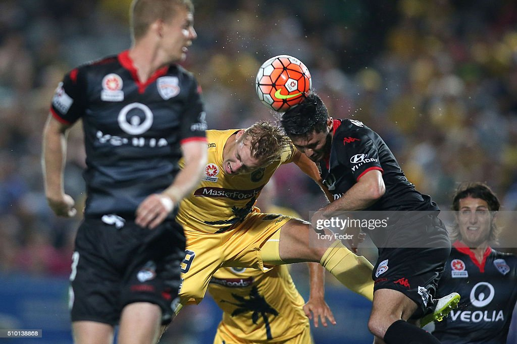 Josh Bingham of the Mariners contests the ball with Dylan McGowan of Adelaide during the round 19 A-League match between the Central Coast Mariners and Adelaide United at Central Coast Stadium on February 14, 2016 in Gosford, Australia.