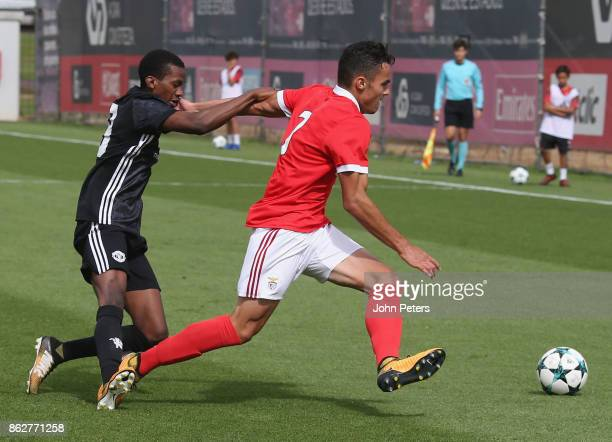 Josh Bohui of Manchester United U19s in action with Pedro Alvaro of Benfica U19s during the UEFA Youth League match between Benfica U19s and...