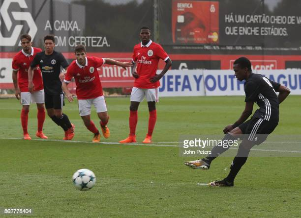 Josh Bohui of Manchester United U19s scores their first goal during the UEFA Youth League match between Benfica U19s and Manchester United U19s at...