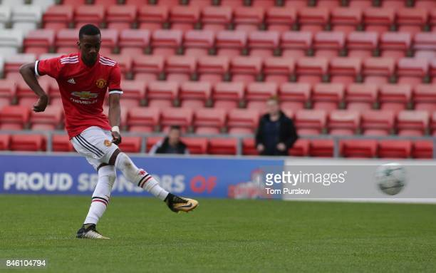 Josh Bohui of Manchester United U19s scores their fourth goal during the UEFA Youth League match between Manchester United U19s and FC Basel U19s at...