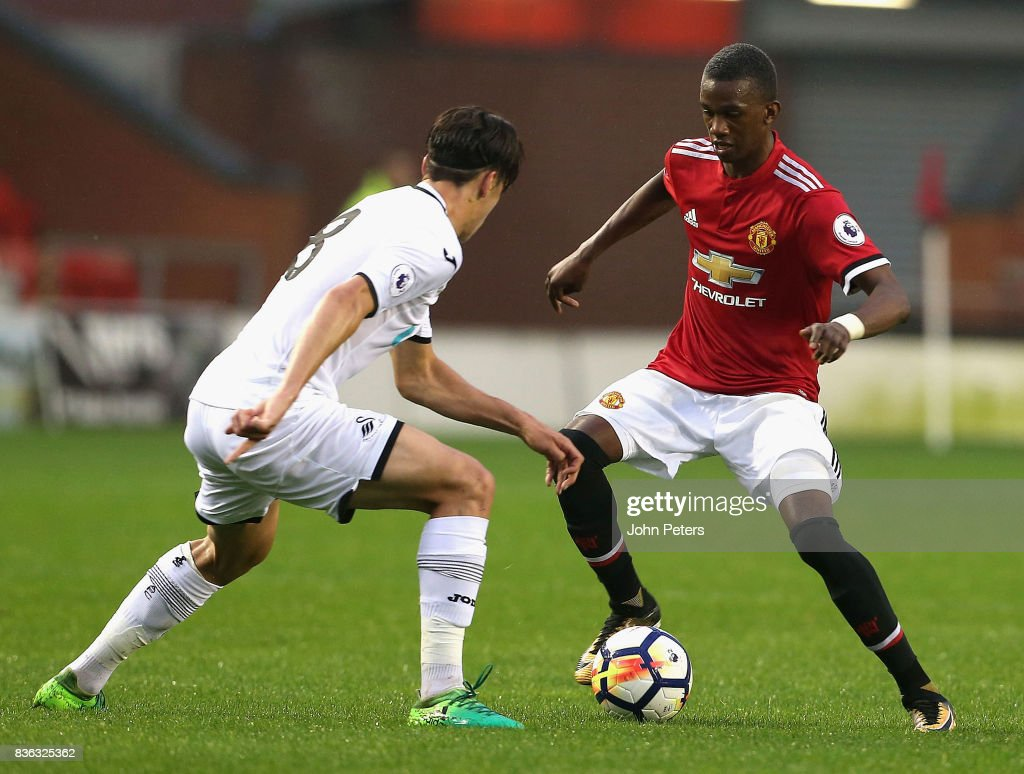 Josh Bohui of Manchester United U23s in action with Jack Evans of Swansea City during the Premier League 2 match between Manchester United U23s and Swansea City U23s at Leigh Sports Village on August 21, 2017 in Leigh, Greater Manchester.
