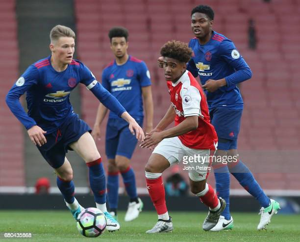 Josh Bohui of Manchester United U23s in action with Reiss Nelson of Arsenal U23s during the Premier League 2 match between Arsenal U23s and...