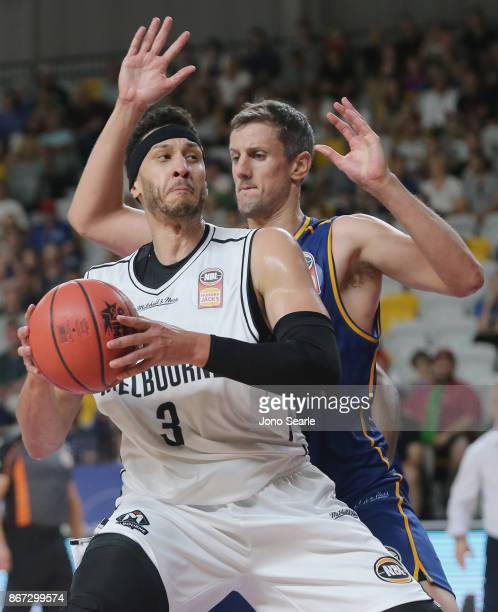 Josh Boone of Melbourne is guarded by Daniel Kickert of Brisbane during the round four NBL match between the Brisbane Bullets and Melbourne United at...
