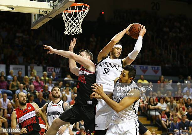 Josh Boone of Melbourne rebounds during the round fourteen NBL match between the Illawarra Hawks and Melbourne United at WIN Entertainment Centre on...