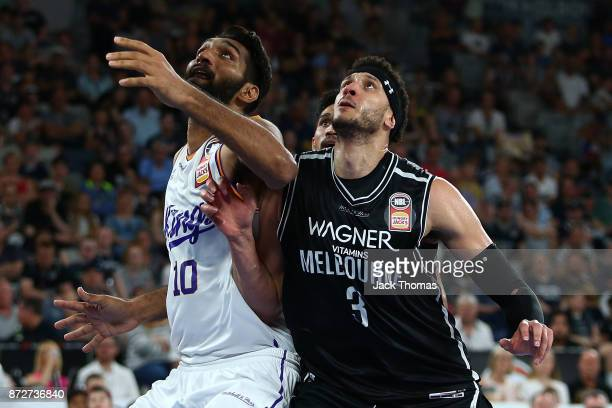 Josh Boone of Melbourne United and Amritpal Singh of the Sydney Kings battle for the rebound during the round six NBL match between Melbourne United...