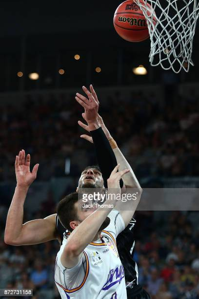 Josh Boone of Melbourne United and Isaac Humphries of the Sydney Kings comepte for the rebound during the round six NBL match between Melbourne...