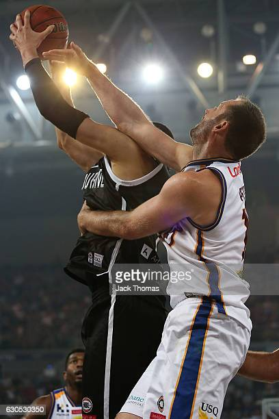 Josh Boone of of Melbourne United rebounds the ball during the round 12 NBL match between Melbourne and Brisbane at Hisense Arena on December 26 2016...