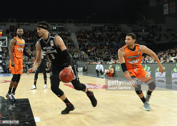 Josh Boone of the Melbourne United controls the ball during the round five NBL match between Melbourne United and the Cairns Taipans at Hisense Arena...