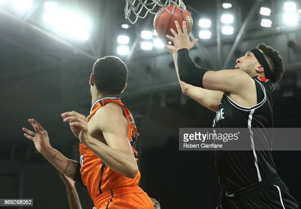 Josh Boone of the Melbourne United scores during the round five NBL match between Melbourne United and the Cairns Taipans at Hisense Arena on...