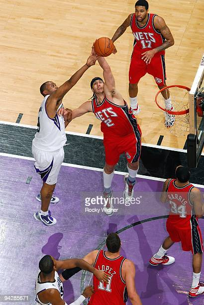 Josh Boone of the New Jersey Nets goes up for the rebound against Kenny Thomas of the Sacramento Kings during the game on November 27 2009 at Arco...
