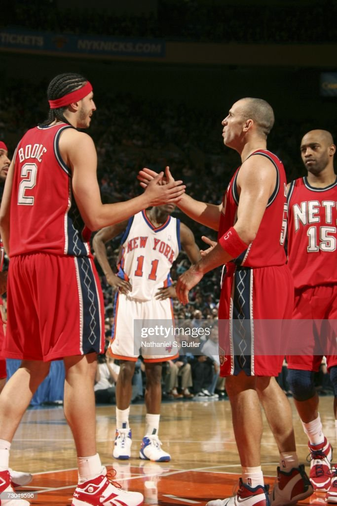 aa2ecfed72c ... Josh Boone 2 of the New Jersey Nets high-fives teammate Jason Kidd ...