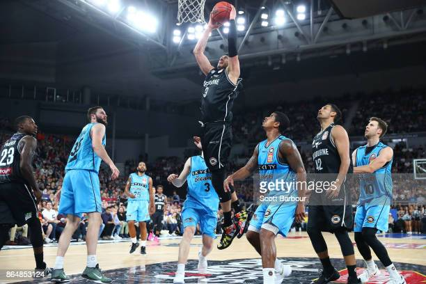 Josh Boone of United dunks the ball during the round three NBL match between Melbourne United and the New Zealand Breakers at Hisense Arena on...