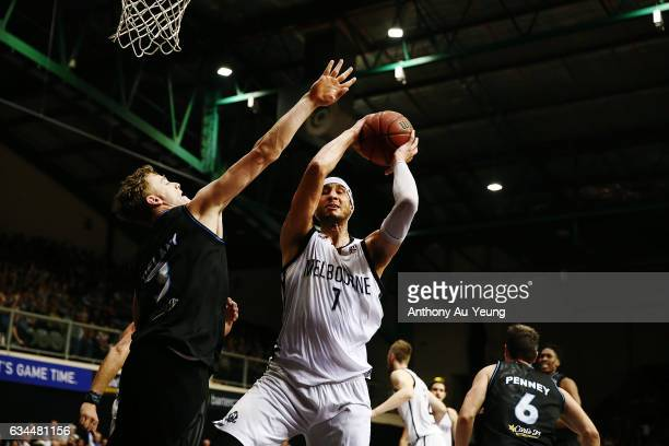 Josh Boone of United grabs a rebound against Finn Delany of the Breakers during the round 19 NBL match between the New Zealand Breakers and Melbourne...