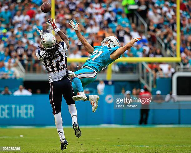 Josh Boyce of the New England Patriots catches a pass past Brent Grimes of the Miami Dolphins during the third quarter of the game at Sun Life...