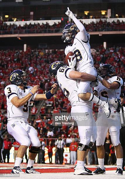 Josh Boyle of the Kent State Golden Flashes celebrates a touchdown with teammates Spencer Keith Kent Cleveland and Chris Humphrey at High Point...