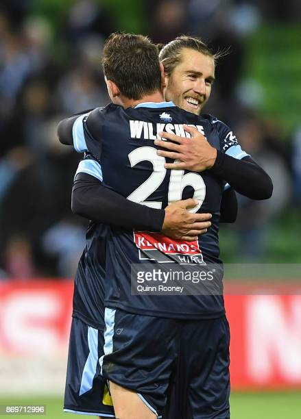 Josh Brillante and Luke Wilkshire of Sydney FC celebrate winning the round five ALeague match between Melbourne City FC and Sydney FC at AAMI Park on...