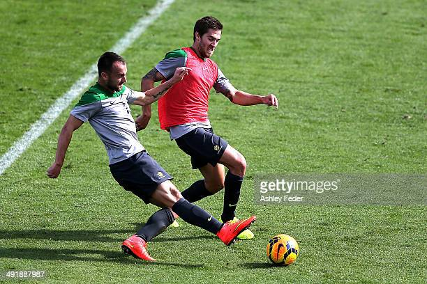 Josh Brillante contests the ball against Ivan Franjic during the Australian Socceroos Fan Day Training Session at Bluetongue Stadium on May 18 2014...