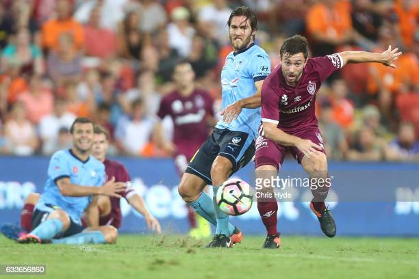 Josh Brillante of Sydney FC and Thomas Oar of the Roar compete for the ball during the round 18 ALeague match between the Brisbane Roar and Sydney FC...