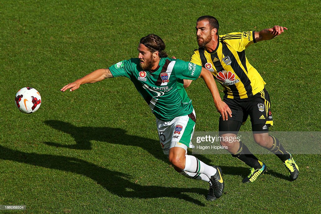 Josh Brillante of the Jets and Manny Muscat of the Phoenix compete during the round three A-League match between Wellington Phoenix and the Newcastle Jets at McLean Park on October 27, 2013 in Napier, New Zealand.