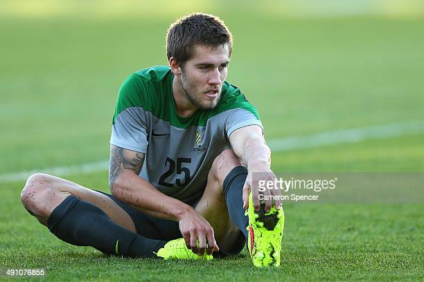 Josh Brillante of the Socceroos stretches during an Australian Socceroos training session at Central Coast Stadium on May 16 2014 in Gosford Australia