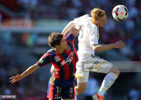 Josh BrindellSouth of the Phoenix contests a header with Craig Goodwin of the Jets during the round 18 ALeague match between the Newcastle Jets and...