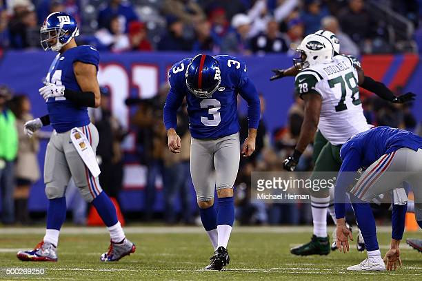 Josh Brown of the New York Giants reacts after missing a game tying field goal in overtime against the New York Jets at MetLife Stadium on December 6...