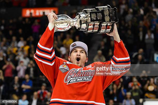 Josh Brown of the Oshawa Generals hoists the Memorial Cup in the air after defeating the Kelowna Rockets during the 2015 Memorial Cup Championship at...