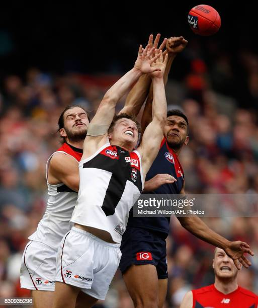Josh Bruce and Jack Billings of the Saints compete for the ball against Neville Jetta of the Demons during the 2017 AFL round 21 match between the...