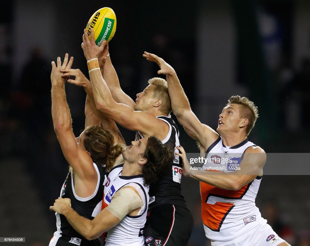 Josh Bruce (left) and Nick Riewoldt of the Saints compete for the ball with Phil Davis (left) and Adam Tomlinson of the Giants during the 2017 AFL round 07 match between the St Kilda Saints and the GWS Giants at Etihad Stadium on May 05, 2017 in Melbourne, Australia.