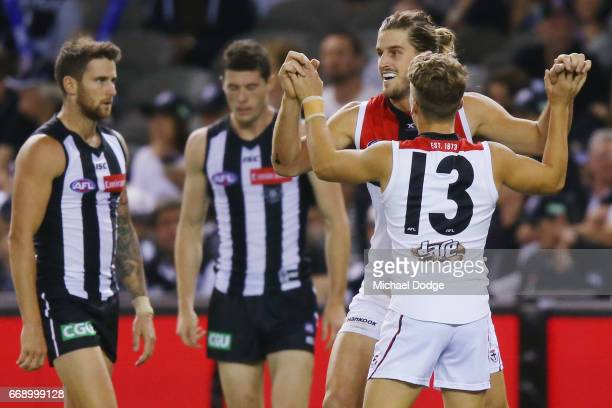 Josh Bruce of the Saints and Jack Lonie celebrates a goal during the round four AFL match between the Collingwood Magpies and the St Kilda Saints at...