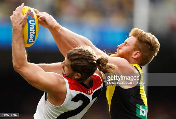 Josh Bruce of the Saints and Nick Vlastuin of the Tigers compete for the ball during the 2017 AFL round 23 match between the Richmond Tigers and the...