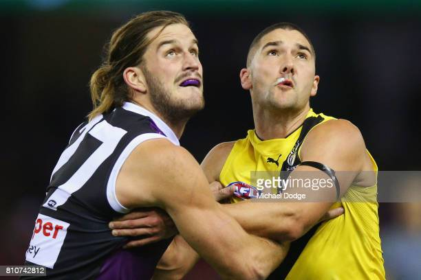 Josh Bruce of the Saints and Shaun Grigg of the Tigers compete for the ball during the round 16 AFL match between the St Kilda Saints and the...