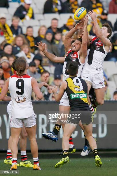 Josh Bruce of the Saints attempts to mark the ball during the round 23 AFL match between the Richmond Tigers and the St Kilda Saints at Melbourne...