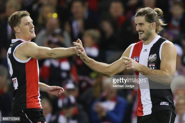 Josh Bruce of the Saints celebrates a goal with Jack Newnes during the round 22 AFL match between the St Kilda Saints and the North Melbourne...