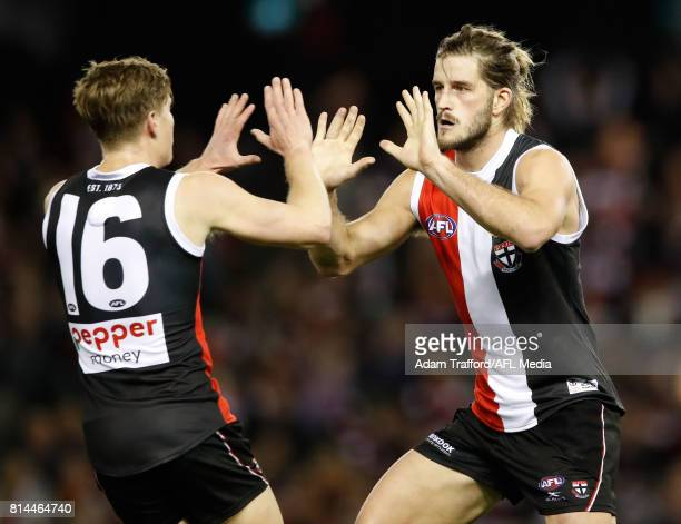 Josh Bruce of the Saints celebrates a goal with Jack Newnes of the Saints during the 2017 AFL round 17 match between the St Kilda Saints and the...