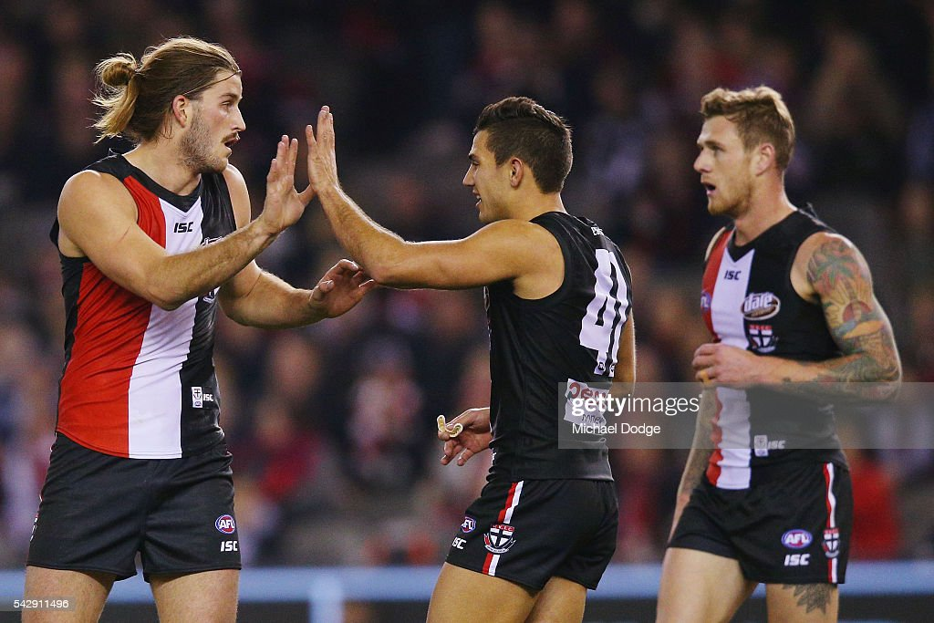 Josh Bruce of the Saints (L) celebrates a goal woth Darren Minchington during the round 14 AFL match between the St Kilda Saints and the Geelong Cats at Etihad Stadium on June 25, 2016 in Melbourne, Australia.