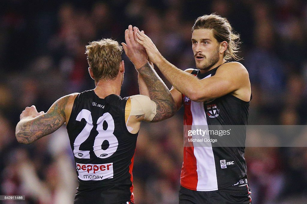 Josh Bruce of the Saints (R) celebrates a goal woth Tim Membrey during the round 14 AFL match between the St Kilda Saints and the Geelong Cats at Etihad Stadium on June 25, 2016 in Melbourne, Australia.