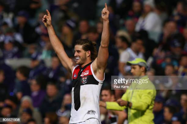 Josh Bruce of the Saints celebrates kicking the winning goal during the round 15 AFL match between the Fremantle Dockers and the St Kilda Saints at...