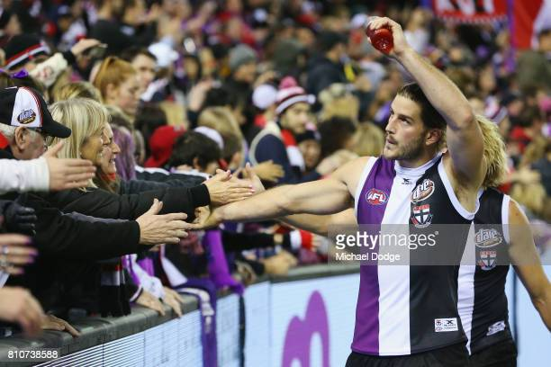 Josh Bruce of the Saints celebrates the win with fans during the round 16 AFL match between the St Kilda Saints and the Richmond Tigers at Etihad...