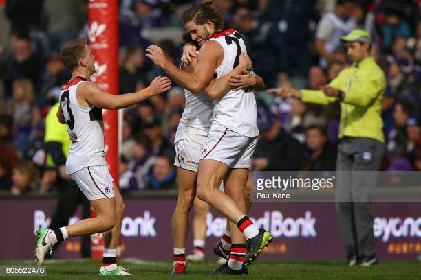 Josh Bruce of the Saints celebrates with Jack Lonie and Jack Steele after kicking the winning goal during the round 15 AFL match between the...