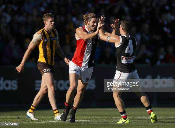 Josh Bruce of the Saints celebrates with Jade Gresham after scoring a goal during the round six AFL match between the Hawthorn Hawks and the St Kilda...