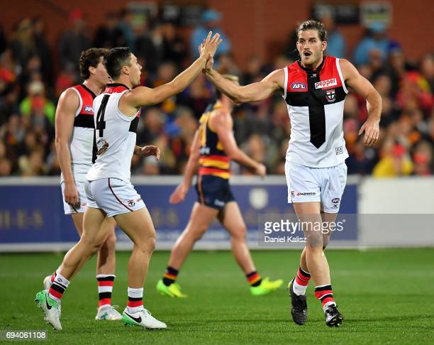 Josh Bruce of the Saints celebrates with Jade Gresham of the Saints after kicking a goal during the round 12 AFL match between the Adelaide Crows and...