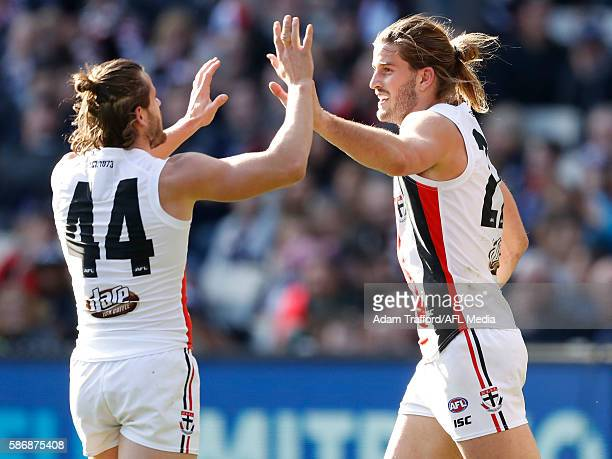 Josh Bruce of the Saints celebrates with Maverick Weller of the Saints during the 2016 AFL Round 20 match between the Carlton Blues and the St Kilda...