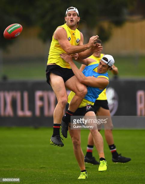 Josh Bruce of the Saints collides with Jack Steele during a St Kilda Saints AFL training session at Linen House Oval on May 23 2017 in Melbourne...