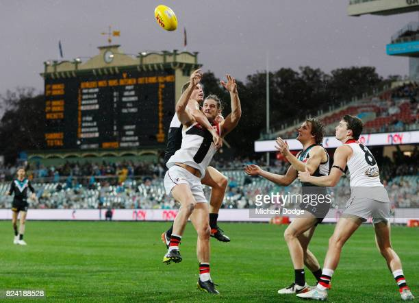 Josh Bruce of the Saints competes for the ball against Clurey of the Power during the round 19 AFL match between the Port Adelaide Power and the St...