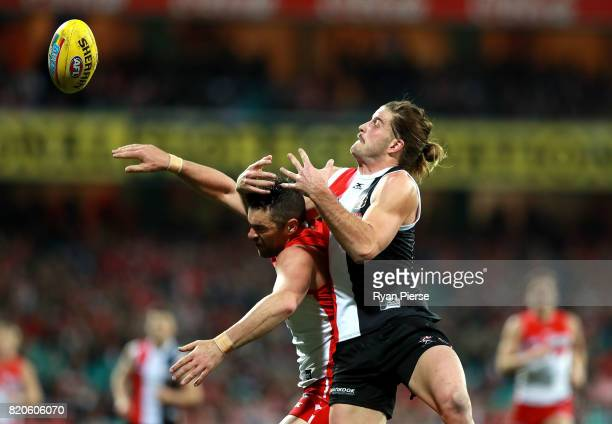 Josh Bruce of the Saints competes for the ball against Heath Grundy of the Swans during the round 18 AFL match between the Sydney Swans and the St...