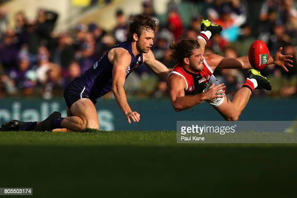 Josh Bruce of the Saints contests for the ball against Joel Hamling of the Dockers during the round 15 AFL match between the Fremantle Dockers and...